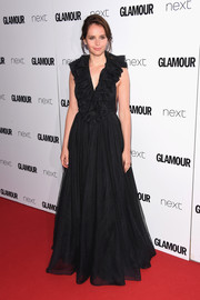 Felicity Jones looked fetching in a black Dior gown with a heavily ruffled neckline at the 2017 Glamour Women of the Year Awards.