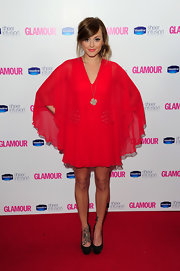 Fearne graced the red carpet in a vibrant sheer dress with studded pumps and a tousled side bun.