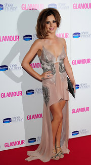 Cheryl wore a modified lace gown with a shortened front hem that showed off her sparkling sandals.