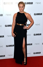 Amy Schumer went the modern-chic route in an asymmetrical black Halston Heritage gown with gold detailing and a thigh-high slit at the Glamour Women of the Year Awards.