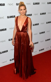 Kate Hudson attended the Glamour Women of the Year Awards looking va-va-voom in a plunging red lurex gown by J. Mendel.