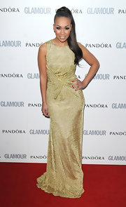 Rebecca Ferguson chose a glittery gold column dress with a gathered waist for her elegant red carpet look during the Glamour Women of the Year Awards.