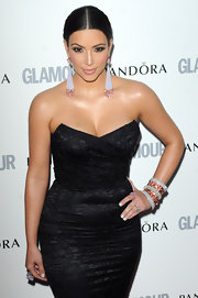 Kim Kardashian brought the bling to the 'Glamour Awards with a wrist full of sparkling bangles.