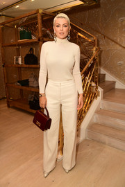 Serinda Swan kept it low-key in a nude turtleneck at the Glamour x Tory Burch Women to Watch lunch.