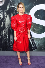 Sarah Paulson jumped in on the mismatched-shoes trend with this red and silver pair by Calvin Klein.