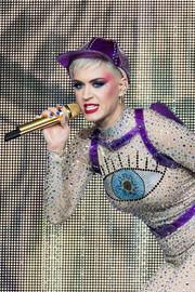 Katy Perry performed at the 2017 Glastonbury Festival wearing a studded purple baseball cap.