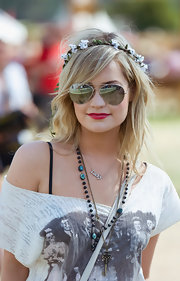 Laura Whitmore topped off her casual Glastonbury Music Festival ensemble in cool style with a pair of silver aviators.