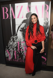 Demi Moore bundled up in a loose red turtleneck for Glenda Bailey's book launch.