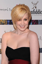 Kellie Pickler was cute as a button in her Herve Lager bandage dress. She showed off her strawberry blonde locks while walking the red carpet.