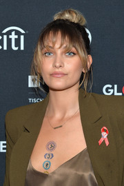 Paris Jackson wore her hair in a loose top bun with choppy bangs when she attended Global Citizen Live.