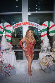 Mariah Carey wrapped up her  figure in a beaded illusion dress for the grand opening of Sugar Factory American Brasserie in Bellevue, Washington.