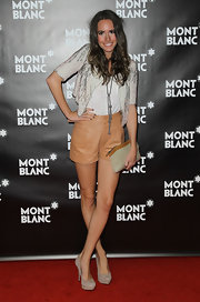 Louise Roe drew attention to her toned gams in high-waisted tan leather shorts.