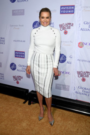 Yolanda Hadid complemented her top with a striped white pencil skirt.