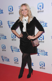 Emma Bunton went for retro cuteness in a black velvet mini dress with a contrast ruffle neckline at the Make Some Noise Gala.