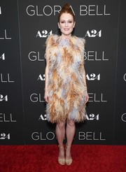 Julianne Moore made a glamorous statement in an autumn-hued feather dress by Givenchy at the New York screening of 'Gloria Bell.'