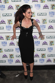 Gloria Estefan rocked out in a sexy black leather dress at Splash Bar.