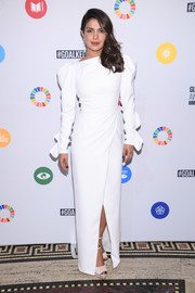 Priyanka Chopra opted for a demure white Christian Siriano gown with puffled sleeves and a crossover skirt when she attended the Global Goals Awards 2017.