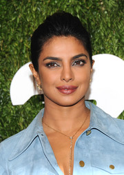 Priyanka Chopra styled her hair into an elegant loose bun for the 2018 Golden Heart Awards.