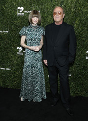 Anna Wintour attended the God's Love We Deliver Golden Heart Awards wearing a teal leopard-print gown.
