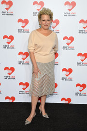 Bette Midler paired a loose pink V-neck sweater with an embellished skirt for the Golden Heart Awards.