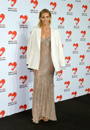 Anja Rubik toned down her slinky gown with a white BLK DNM blazer when she attended the Golden Heart Awards.