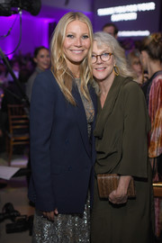 Gwyneth Paltrow layered a navy blazer over a silver sequin dress for her Golden Heart Awards look.