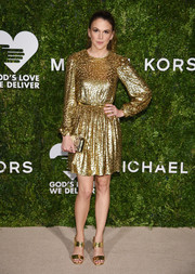 Sutton Foster matched her frock with a pair of gold broad-strap heels, also by Michael Kors.