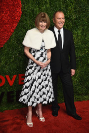 Anna Wintour graced the God's Love We Deliver, Golden Heart Awards wearing a monochrome cocktail dress with all-over feather-like detailing.
