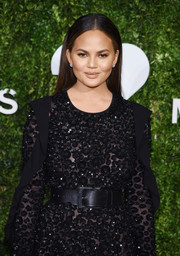 Chrissy Teigen accentuated her tiny waist with an oversized black belt by Michael Kors at the God's Love We Deliver, Golden Heart Awards.