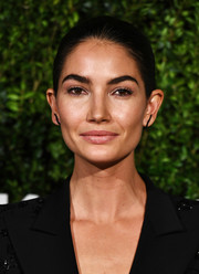 Lily Aldridge went simple and classic with this slicked-back bun at the God's Love We Deliver, Golden Heart Awards.