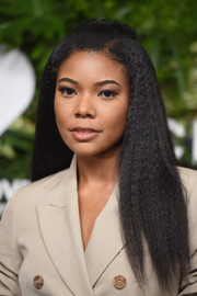 Gabrielle Union wore her hair in a simple half-up style at the Golden Heart Awards.