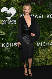Amber Valletta looked jazzy in a fringed and sequined LBD by Michael Kors at the Golden Heart Awards.