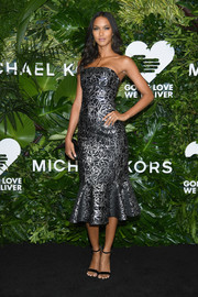 Lais Ribeiro cut a feminine silhouette in a Michael Kors metallic strapless dress with a ruffle hem at the Golden Heart Awards.