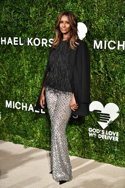 Iman made an appearance at the God's Love We Deliver, Golden Heart Awards rocking a pair of embellished silver pants by Michael Kors.