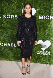 Chrissy Teigen arrived for the God's Love We Deliver, Golden Heart Awards looking ultra sophisticated in a beaded and ruffled LBD by Michael Kors.