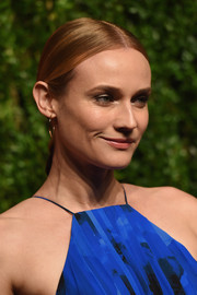 Diane Kruger sported a slicked-down, center-parted low braid at the God's Love We Deliver, Golden Heart Awards.