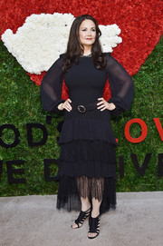 Lynda Carter chose black strappy sandals to complete her ensemble.