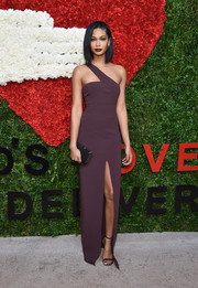 Chanel Iman oozed sexy sophistication in a plum-colored one-shoulder gown by Michael Kors during the Golden Heart Awards.