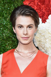 Elettra Wiedemann accessorized with a delicate layered gold necklace.