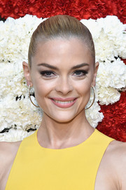 Jaime King spiced up her look with a pair of curved dangling diamond earrings.