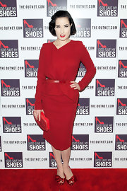 Dita opted for red stain peep-toe pumps with bow ribbon accents to punctuate her red carpet look.
