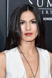 Elodie Yung opted for a simple center-parted style when she attended the 'Gods of Egypt' premiere.