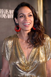 Rosario Dawson topped off her dazzling look with a pair of red hoop earrings.