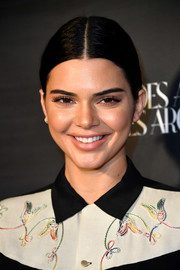 Kendall Jenner went for a simple center-parted chignon when she attended the What Goes Around Comes Around one-year anniversary party.