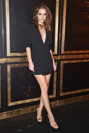 Barbara Palvin styled her dress with elegant gold slingbacks.