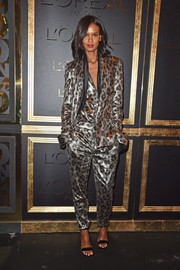 Liya Kebede rocked a metallic leopard-print pantsuit by Haider Ackermann at the Gold Obsession Party.