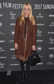 Chloe Sevigny attended the Sundance premiere of 'Golden Exits' wearing a brown suede coat over a print dress.