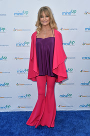 Goldie Hawn brightened up the Love In For Kids event with her drapey fuchsia pantsuit and purple cami combo.