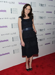 Alexis is a tweed sweetheart in a textured navy dress at the Shine On Awards.