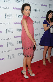 Camilla Belle gave her sequined pink halter dress an edge with suede studded Luxura heels with python heels.